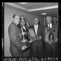 Buzzie Bavasi, Gene Autry and Rod Dedeaux with Shriner Mark T. Gates in Los Angeles, Calif., 1964