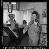 15 year old violinist Glenn Dicterow rehearsing with his parents Harold and Irina in Los Angeles, Calif., 1964