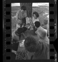 Elsa L. Frackelton and Iris Knapp reading to a group of boys at MacLaren Hall, a children's shelter in El Monte, Calif., 1964