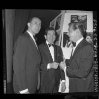 Henry Mancini, Trini Lopez and John Gary backstage at the Grammy Awards dinner, 1964