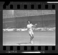 Actor-singer Ricky Nelson playing in the 30th annual Motion Picture Tennis Association Tournament in Encino, Calif., 1964