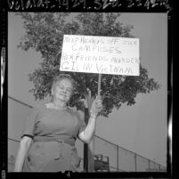 "Woman holding placard stating ""Keep Healeys Off Our Campuses..."" in protest over Dorothy Healey's Cal State appearance, 1964"