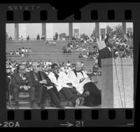 Dr. Martin Luther King Jr. speaking at civil rights rally at Los Angeles Coliseum, 1964