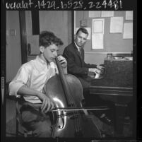 Fourteen year old Avner Ash playing cello with teacher, Peter Schartz, 1964