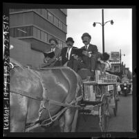Three Los Angeles officials riding the 73rd anniversary Union Rescue Mission's Gospel Wagon, 1964