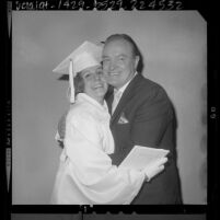 Bob Hope embracing his daughter, Nora after her graduation from Providence High School in Burbank, Calif., 1964