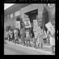 Pickets march at Los Angeles' Catholic chancery in support of Compton priest Father William DuBay, 1964
