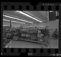 People shopping in the clothing section of a supermarket in Los Angeles, Calif., 1964