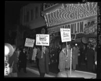 "American Legion Un-American activities committee members picketing premiere of the film, ""Moulin Rouge"" in Los Angeles, Calif., 1952"