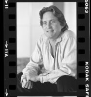Actor and producer Michael Douglas, seated portrait, 1984