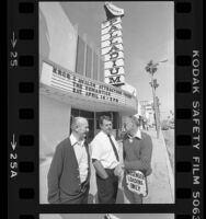 Henry Lyman, George Ullman and Dick White standing under the marquee of the Hollywood Palladium in Hollywood, Calif., 1984