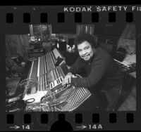 Musician George Duke in control room of recording studio, 1984