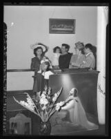Retiring pastor of Filipino Christian Church having his children christened by his successor in Los Angeles, Calif. 1946
