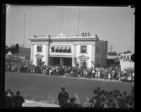 Van Nuys City Hall dedication: crowd lining street outside old city hall [Engine Co. No. 39], 1933