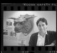 "Producer-director Ivan Reitman posing with head of Terror Dog creature from ""Ghostbusters"" movie, 1984"