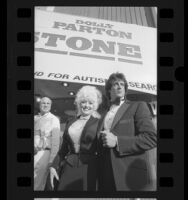 "Dolly Parton and Sylvester Stallone arriving at benefit showing of motion picture ""Rhinestone"" in Los Angeles, Calif., 1984"