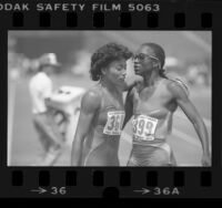 Florence Griffith and Valerie Brisco-Hooks after running 400 meters at 1984 Olympic trials in Los Angeles, Calif.