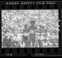 Jeanette Bolden and Clotee Cowans crossing finish line during 100 meter dash at the 1984 U.S. Olympic trials in Los Angeles, Calif.