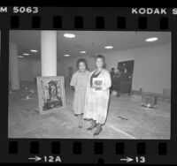 Museum of African American Art in Los Angeles founder, Samella Lewis and director Mary Jane Hewitt amongst construction of museum, 1984