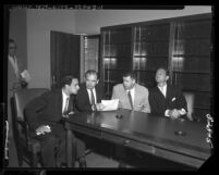 Senator Joseph McCarthy seated with United States Attorney, Laughlin Waters, Roy M. Cohn, and G. David Schine, 1953