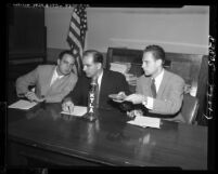Senator Joseph McCarthy seated with Ray M. Cohn and G. David Schine during committee inquiry, 1953