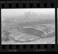 Aerial view of Dodger Stadium with downtown Los Angeles in background, Los Angeles, 1984