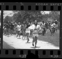 People participating in run during the Jim Thorpe Memorial Pow Wow and Games at Whittier Narrows Recreation Area, Calif., 1984