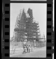 Four girls looking at scaffolding surrounding Watts Towers in Los Angeles, Calif., 1984