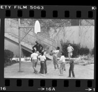 Group of boys playing basketball at Los Angeles County Juvenile Hall, 1984