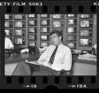 ABC producer Jeff Ruhe in his Hollywood, Calif. control center that contains 77 TV sets, 1984