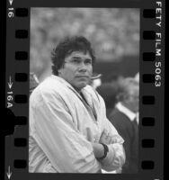 Jim Plunkett on the sidelines during Los Angeles Raiders game, 1984