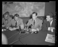 California Congressman Donald L. Jackson seated with three unidentified men at press conference in Los Angeles, Calif., 1953