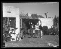 Amelia Earhart, George P. Putman and Paul Mantz inspecting Earhart's new home in Los Angeles, Calif., 1935