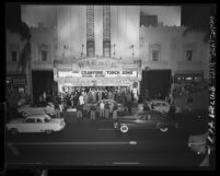 "Automobiles passing by crowds outside Warner Bros. Theater for the ""Torch Song"" movie premiere in Los Angeles, Calif., 1953"