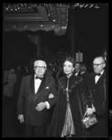 "Actress Joan Crawford on the arm of Louis B Mayer at the ""Torch Song"" movie premiere in Los Angeles, Calif., 1953"