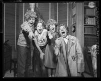 Harpo Marx and three of his children joking around wearing Harpo wigs in Los Angeles, Calif., 1954