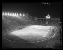 Night scene of Los Angeles Rams vs. Washington Redskins game at Los Angeles Coliseum, 1946