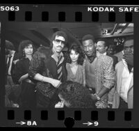 "Lionel Richie, Apollonia Kotero, and Eddie Murphy at premiere of motion picture ""Purple Rain"" in Los Angeles, Calif., 1984"