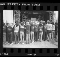 Line of heavy metal fans wearing concert t-shirts watching band on stage at Starlight Theater in Burbank, Calif., 1984