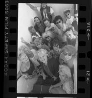 Casting director, Janet Cunningham, with a group of punk movie extras, Los Angeles, Calif., 1984