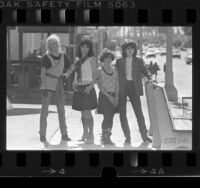 Los Angeles based music group, The Bangles, posing on street in Los Angeles, Calif., 1984