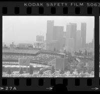 Cityscape of Dodger Stadium with skyline of downtown Los Angeles in background, 1984