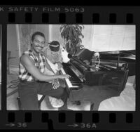 Musician Ray Parker Jr., seated at piano, 1984