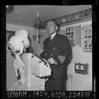 Naval captain Goro Nakijima, at wheel of Japanese freighter Daiwa Maru, 1964