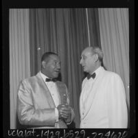 Carl T. Rowan and Dr. Lewis Webster Jones at the National Conference of Christians and Jews, 1964