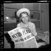 17 year old Mia Farrow holding Peyton Place newspaper as she waits for contract approval in Santa Monica courthouse, 1964