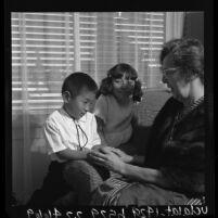 Ora Sauder with her two adopted Korean children, Anaheim, Calif., 1964