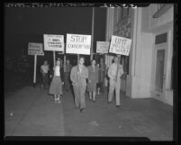 Members of Fellowship of Reconciliation shown marching in protest against draft in Pasadena, Calif., 1948
