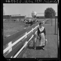 Dairy farmer Mrs. Arthur Atsma in an authentic Frisian costume with daughter in Dairy Valley, Calif., 1964