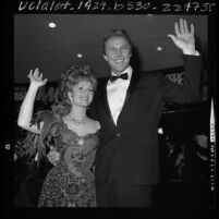 "Debbie Reynolds and Harve Preshell waving to fans at premier ""The Unsinkable Molly Brown"" in Los Angeles, Calif., 1964"